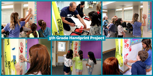 5th grade students putting handprints on a wall