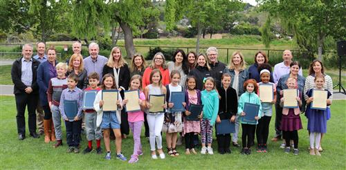 3rd grade students with certificates